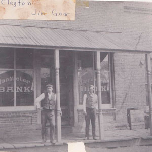 Luke Clayton and Jim Goar in front of Van Meter Bank